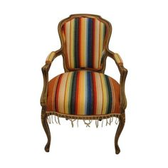 Custom Bergere chair custom upholstered in Serape. Would be great as an accent chair in a modern room.