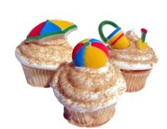 Fun & Colourful #Beach ball and umbrella #Cupcakes We totally love and had to share! Great #CakeDecorating!