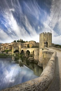 Besalú is a town in the region of Garrotxa, in Girona, Catalonia, Spain. The town's most significant feature is its 12th-century Romanesque bridge over the Fluvià river, which features a gateway at its midpoint.
