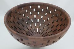 "Open Segmented Walnut Bowl of 145 pieces of Walnut.  The open spaces add a great deal of interest with the angles of each piece of wood. It is 10.5""dia x 5.5""H. A decorative piece of art for the table or mantel."