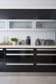 For the modern design lover, this kitchen's sleek lacquer cabinets are as smooth as it gets. (Cultivate.com)