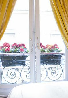 Saint Julien is a gorgeous, short term #ParisPerfect rental with French doors facing the beautiful Champ du Mars Gardens with views of the Eiffel Tower through the trees to the right.