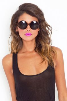 A simple black tank .. Perry Herring lipstick .. 1950s shades and tousled hair is a classic summer look