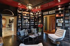 Aura of New Orleans or old Miami. A veranda with 6 sets of French doors, grand foyer, natural light-filled spaces with rich mahogany wood. Library has dramatic setting with stain glass windows and black builtin bookshelves