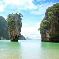 Slip away to beautiful Phang Nga Bay, #Thailand, where sheer limestone karsts rise dramatically out of the water.