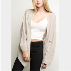 Brandy Melville Caroline cardigan *NO TRADES* Brandy Melville Caroline cardigan. Not sure if it is cream or tan, purchased a few years ago from the brandy store. Worn and washed multiple times, always hang dried, not shrunken AT ALL! Has some signs of wear, some light snags, but no holes or stains. Please see photos. **NO TRADES OR MODELING** Brandy Melville Sweaters Cardigans