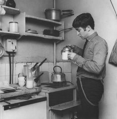 John Lennon — John having tea in Paul's kitchen.
