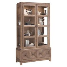 """Display cherished heirlooms or bone china in this glass-paneled display cabinet, featuring 3 adjustable shelves and 2 blockfront bottom drawers for ample storage.    Product: Display cabinetConstruction Material: Cane wood and glassColor: NaturalFeatures:  Three adjustable shelvesTwo drawersTwo doorsDimensions: 84"""" H x 48"""" W x 18"""" DAssembly: Assembly required"""