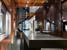 Penthouse at the Candy Factory Lofts by Johnson Chou  especially love the stairtwirl!!!