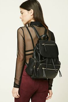 A structured faux leather backpack featuring a top handle, flap top with magnetic and drawstring closure, adjustable shoulder straps, four exterior zippered pockets, and two interior slip pockets.