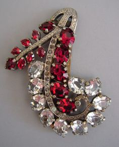 """EISENBERGunsigned red and clear unfoiled rhinestones dress clip set in gold tone. These are reallybrilliant stones, circa 1940s, 3""""."""