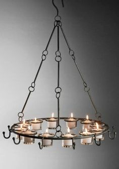 Add a warm ambiance with this hanging metal candle chandelier. The candle holder holds twelve tealight or votive candles in the included gl. Bottle Chandelier, Lantern Chandelier, Rustic Chandelier, Candle Lanterns, Votive Candles, Chandeliers, Save On Crafts, Vintage Candles, Home