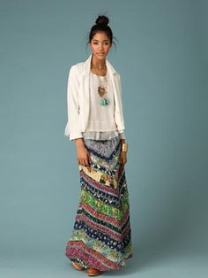 Bright boho maxi, feminine blouse & cream blazer. Stunning turquoise pendant and cute top knot. Love this combo for fall.
