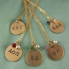 www.leahmcintyre.com  14k GF dime sized sorority necklaces with gemstone beads that correspond with the sorority's colors.