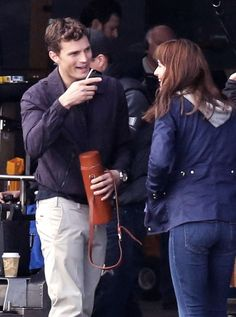 Jamie Dornan & Dakota Johnson on set of Fifty Shades of Grey in Vancouver - 14 Oct 2014 Click on for more FSOG Set photos lovefiftyshades.com   twitter   instagram   pinterest   youtube