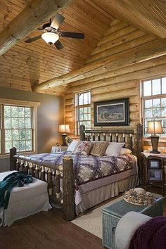 Log cabin master bedroom with log bed frame.