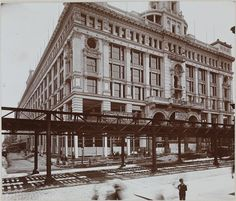 Shopping during the Gilded Age in NYC.  Siegel-Cooper Department Store - 6th Ave at 18th St. With the 6th Ave. elevated tracks.