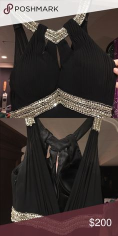 GORGEOUS black La Femme gown This gown has only been worn once and is in perfect condition. Size 0 beautiful silver embellishment on top. Long and flattering La Femme Dresses Prom