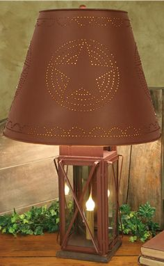 Another antique reproduction of lighting, this Large Milk House 4-way lamp is definitely modeled from an earlier time.  Comes in red or black.  $115.00