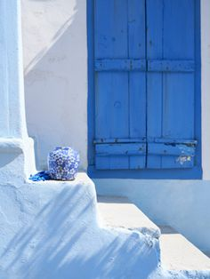 Blue shuttered window! http://cococozy.com