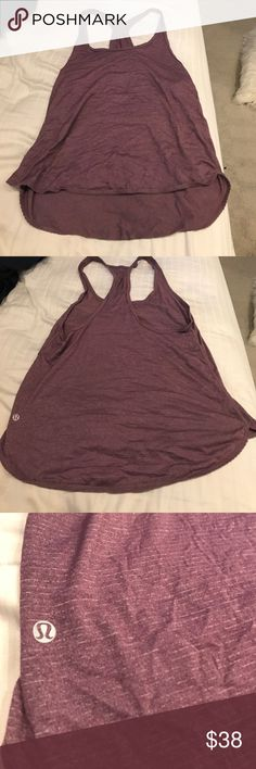 Lululemon purple racer back loose fitting tank Lululemon purple racer back loose fitting tank with low dips on the sides, longer in the back and looks great with leggings! Size 6 lululemon athletica Tops Tank Tops