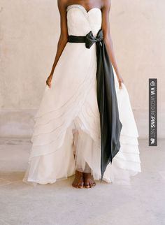 Awesome - Black detail is set to be a hot bridal trend for 2014 - love how this black sash adds drama to a pretty gown | CHECK OUT MORE GREAT BLACK AND WHITE WEDDING IDEAS AT WEDDINGPINS.NET | #weddings #wedding #blackandwhitewedding #blackandwhiteweddingphotos #events #forweddings #iloveweddings #blackandwhite #romance #vintage #blackwedding #planners #whitewedding #ceremonyphotos #weddingphotos #weddingpictures