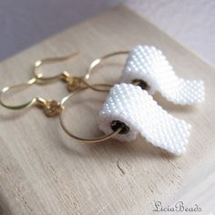 The gift for the girl who has everything....Toilet Paper earrings on gold hook earrings  allow by LiciaBeads, $36.00