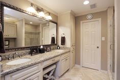 The MASTER BATHROOM has a double sink vanity with knee space. Fully framed vanity mirror with decorative lighting. Two built-in linen cabinets