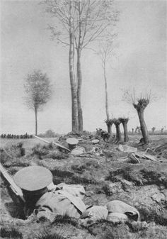 """British Infantry lying in """"scrapes""""; quickly dug, improvised shallow trenches, watching as German troops advance in the distance at the Battle of Mons, August 24th 1914."""