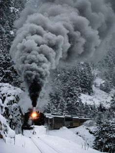 This winter picture shows a train plowing through deep snow in the heart of the San Juan Mountains. Photographer Paul Chesley captured this image