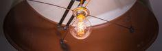 Industrial styled designer hanging lampshade handmade from steel barrels.