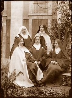 Celine Martin (back left) took this photo on November 20, 1894. The others are Mother Agnes (Pauline), Mother Marie de Gonzague, Sr. Marie of the Sacred Heart (Marie), and St. Therese. See my St. Therese board for more.
