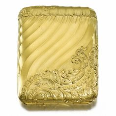 A FABERGÉ GOLD CIGARETTE CASE, WORKMASTER MICHAEL PERCHIN, ST PETERSBURG, CIRCA 1890 Estimate: 10,000 - 14,000 GBP  LOT SOLD. 157,250 GBP  (Hammer Price with Buyers Premium) in rococo taste, cast and chased with matte texture swirling bands within raised rocaille foliage, opening in two halves by means of a slight depression below the lid, struck with workmasters initials and Fabergé in Cyrillic; From the Romanov Heirloom sale at Sotheby's.