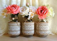 PERFECT centerpieces!! (Burlap, lace, coral and ivory roses)