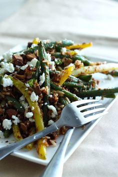 beans + rice toss with spicy roasted almond salsa and goat cheese