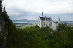 ***Neuschwanstein Castle, the real Cinderella's Castle, is located outside of Munich.  Hiking across a suspended bridge nearby provides the best views.