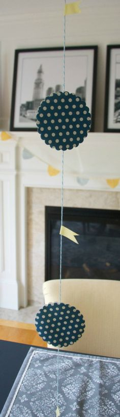 Easy DIY graduation party decor- garland made of scalloped paper punches and washi tape flags #graduation #graduationparty #diy
