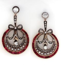 A pair of Edwardian platinum, 14 karat yellow gold, diamond and ruby pendant earrings, circa 1905, containing approximately 1.87 carats of diamonds and 3.50 carats of rubies. #Edwardian #earrings