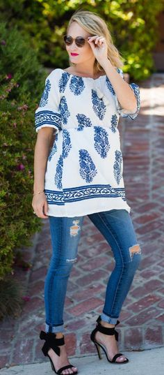 I love this chic blue and white floral print blouse because it is understated, but sexy at the same time.