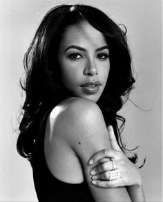 Aaliyah. I'm a big lover of Rhythm Blues (RandB). And by far she has always been my favorite when it came to all the 90s! Sadly this great artist died in 2001 at 21. In my opinion, she left behind a legacy :).