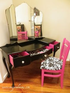 Old desk painted black and pink with an added mirror and fabric lined drawers. Take any chair, paint it and line it with the same fabric inside the drawers for a cute matching vanity table and chair. So cute!