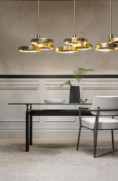 Price above excludes VAT  With three intersecting brass discs hung from a single drop rod, the Triarc  Chandelier makes a dramatic impression. Grouped together with two or more  pendants it creates a sculptural focal point. Available with opal or black  diffusers.  Specifications:  H:As required W:600mm