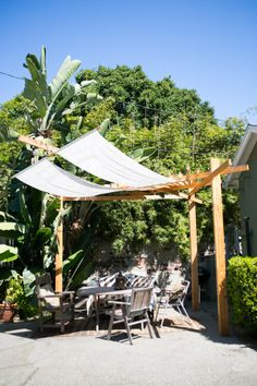 handmade shade: We came up with a three-legged, 10' tall pergola with a 16' shade arm and an old Indian tapestry that hangs like a sail in the wind. All pieces are routed out so it fits together like Lincoln Logs.