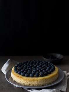 Lemon ricotta baked cheesecake with blueberries
