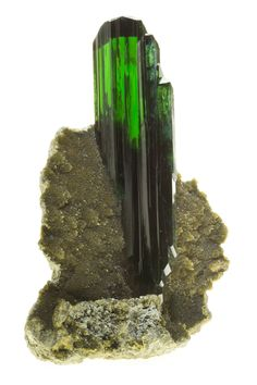 Vivianite on Siderite, Huanuni, Dalence Prov., Oruro Dept., Bolivia. I've seen a lot of Vivianites but not like this one. A single isolated large perfect crystal of the finest possible gem green color. The crystal is nearly flawless throughout, with perfect termination and sitting beautifully upright on a nice matrix of dark yellowish Siderite. Vivianite simply does not get better. This and more rare mineral specimens for sale on CuratorsEye.com