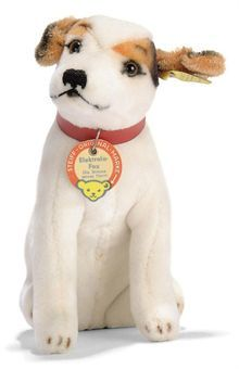 A STEIFF SEATED ELEKTROLA-FOX DOG, (4420/17), white dralon, brown and black patches, brown and black plastic eyes, mohair ears, black stitching, red collar, script button with yellow cloth tag and chest tag, 1968-69 --7in. (18cm.) high