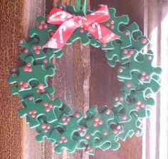 Puzzle Piece Wreath: Made from puzzle pieces that have been painted green with little red berries. Created by Kelly / bzlittlechristmaself. You could also decorate with buttons, jewels, etc. and could put your student's picture in the middle. Could also make Christmas trees. Really cute!