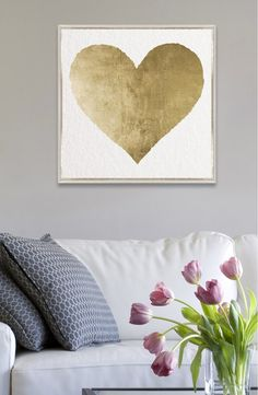A gilded heart shines out from this lovely canvas print professionally hand-set in a shadowbox frame.