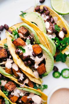 Perfectly seasoned butternut squash with black beans loaded in a tortilla with the best sauce. These butternut squash tacos are loaded with flavor! Veggie Recipes, Mexican Food Recipes, Vegetarian Recipes, Healthy Recipes, Dessert Recipes, Vegetarian Tacos, Trifle Desserts, Mexican Dishes, Chef Recipes