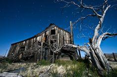 Full moon illuminates an abandoned house in the Mojave Desert, California